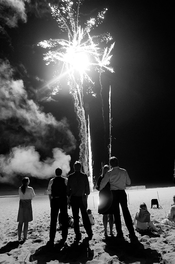 Beachside fireworks made for a special ending to this wedding. Photo by Q Weddings via Style Me Pretty