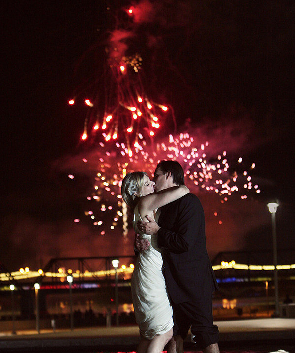 Fireworks were reflected in the water at this romantic wedding. Photo by Sedona Bride Photographers via Style Me Pretty