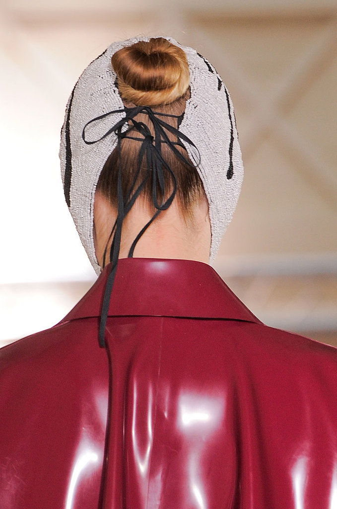 There wasn't much for makeup on the Maison Martin Margiela runway, but the hair was twisted into a midheight bun.