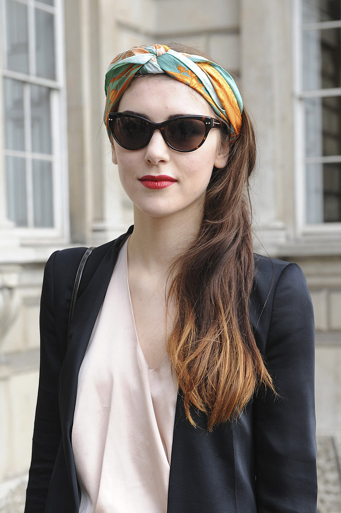Want to hide unruly roots? Try tying up a twisted headband like this one. Swipe on a touch of red lipstick, and voilà!