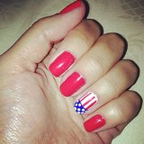 If you want red to be the main attraction of your manicure, simply paint a flag design on your accent nail. Source: Twitter user MrsAlexSanz