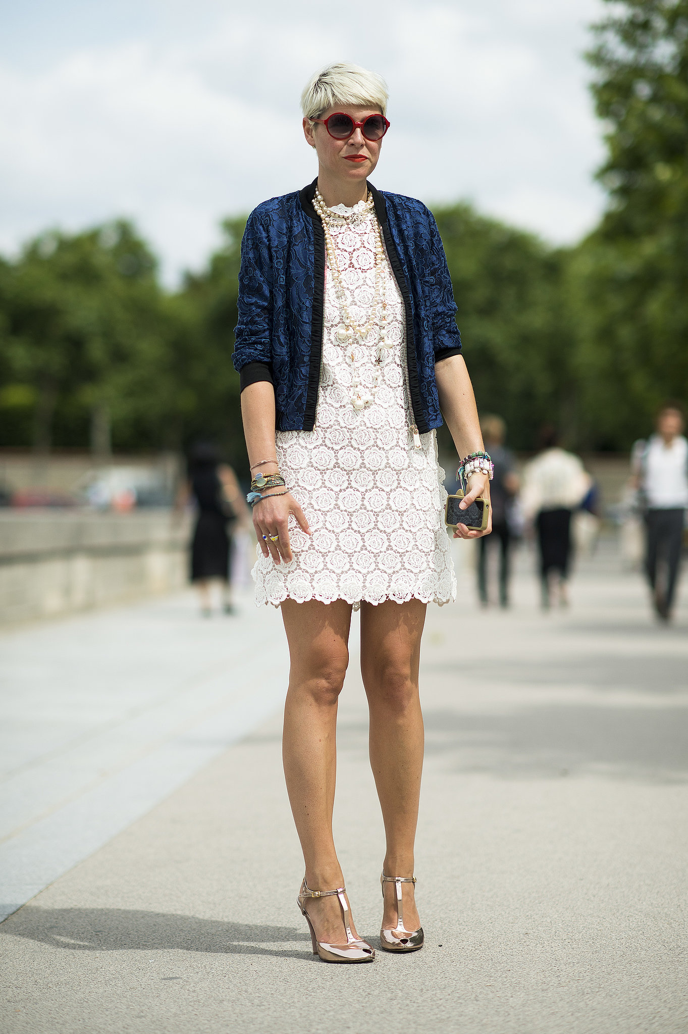 Elisa Nalin made a lacy LWD show-worthy with a deep blue jacket, metallic heels, and loads of pearls. Source: Le 21ème | Adam Katz Sinding