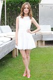Rose Byrne attended an outdoor event in Montauk wearing a white fit-and-flare dress with pink cap-toe pumps.