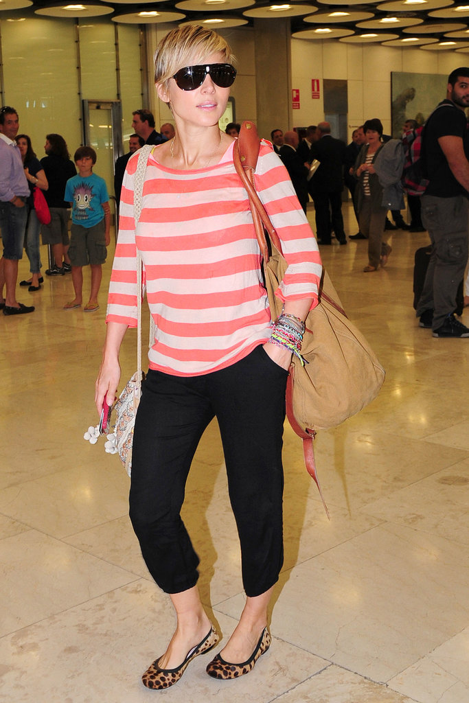 Any terminal gets brightened by bold orange stripes like the sweater Elsa Pataky picked for a recent trip.