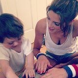 Ashley Greene sported patriotic wristbands while hanging out with a tiny pal. Source: Instagram user ashleygreene