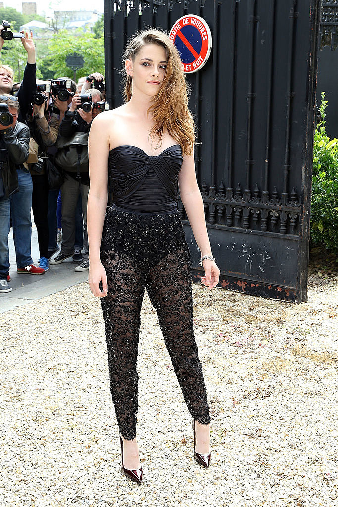 Kristen Stewart wore a sexy Zuhair Murad lace jumpsuit for the designer's show on Thursday.