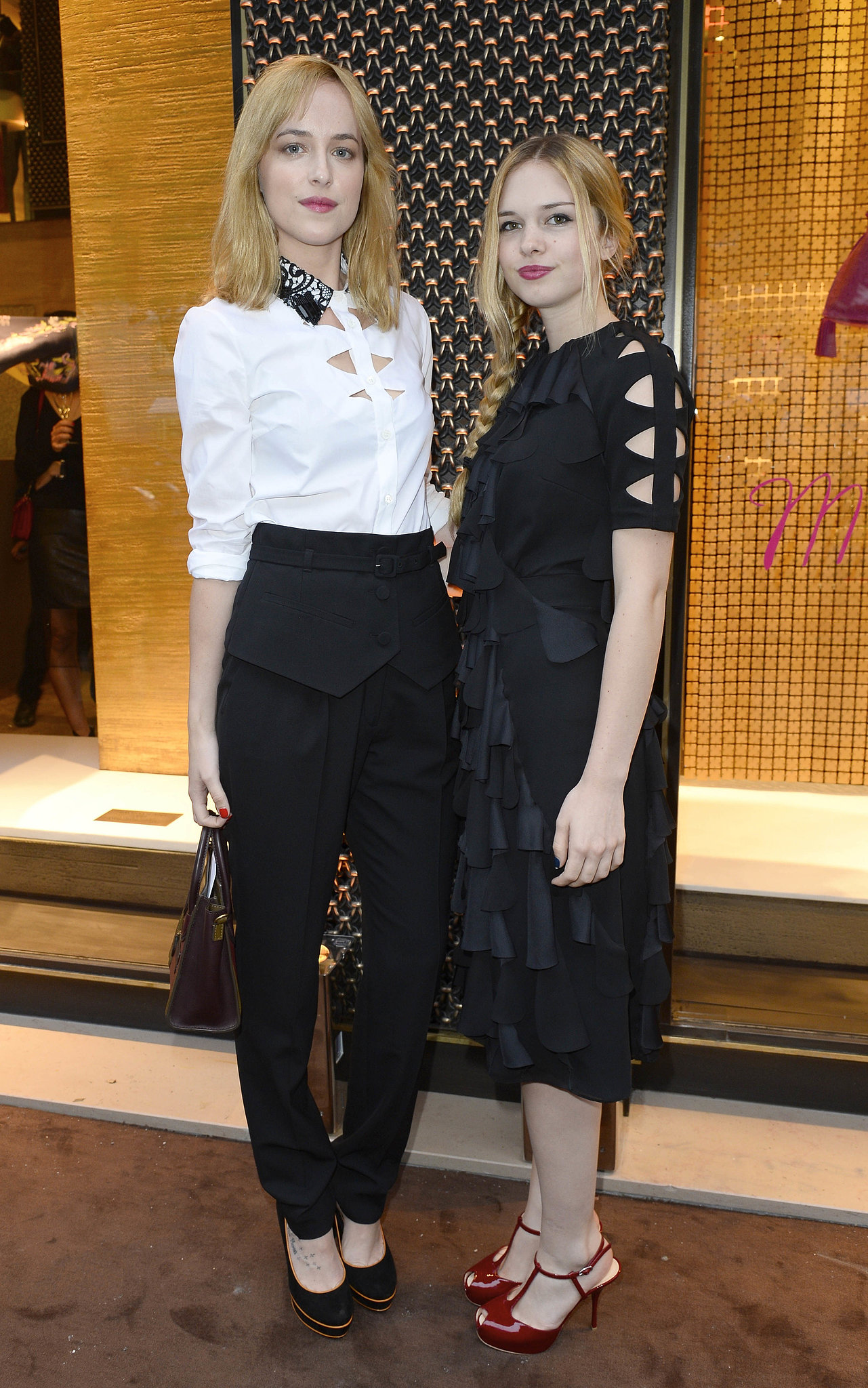 Dakota Johnson and Stella Banderas doubled up on the blond power at the Paris Loewe boutique opening.