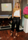 Rita Ora perfected the casual leather look, pairing baggy cropped pants with a loose white tank and black sandals.