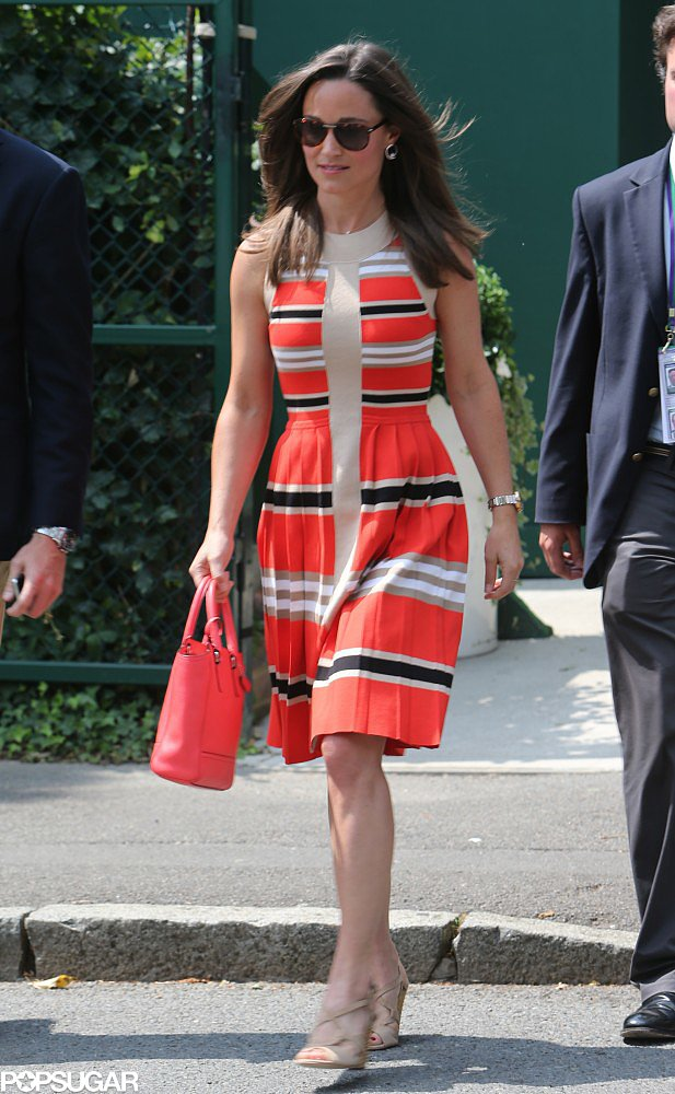 Pippa Middleton showed off a pretty dress with red, black, white, and beige stripes on her way to Wimbledon. She finished with a matching red Coach bag and nude sandals.