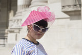 A bubblegum pink headpiece and cat eye shades ensured that this showgoer got noticed.
