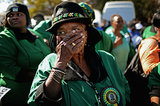 One woman became emotional as the African National Congress Women's League sang and prayed outside the hospital.