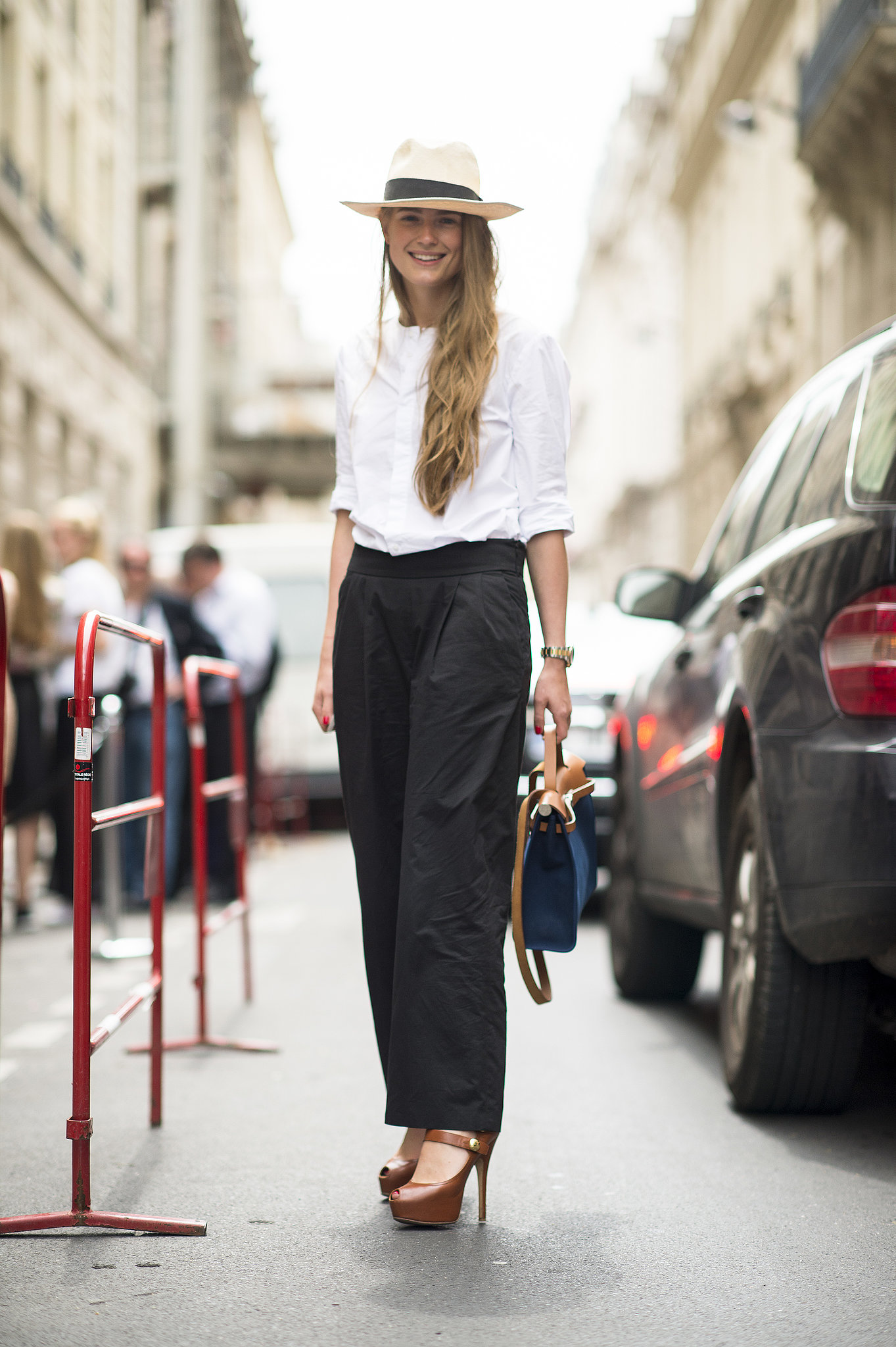 Wide-leg trousers are undeniably feminine when styled with a spiky-heeled shoe. Source: Le 21ème | Adam Katz Sinding