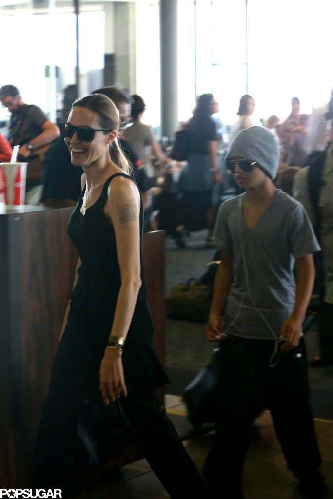 Angelina Jolie smiled as she touched down in Hawaii with Maddox Jolie-Pitt in July 2013.