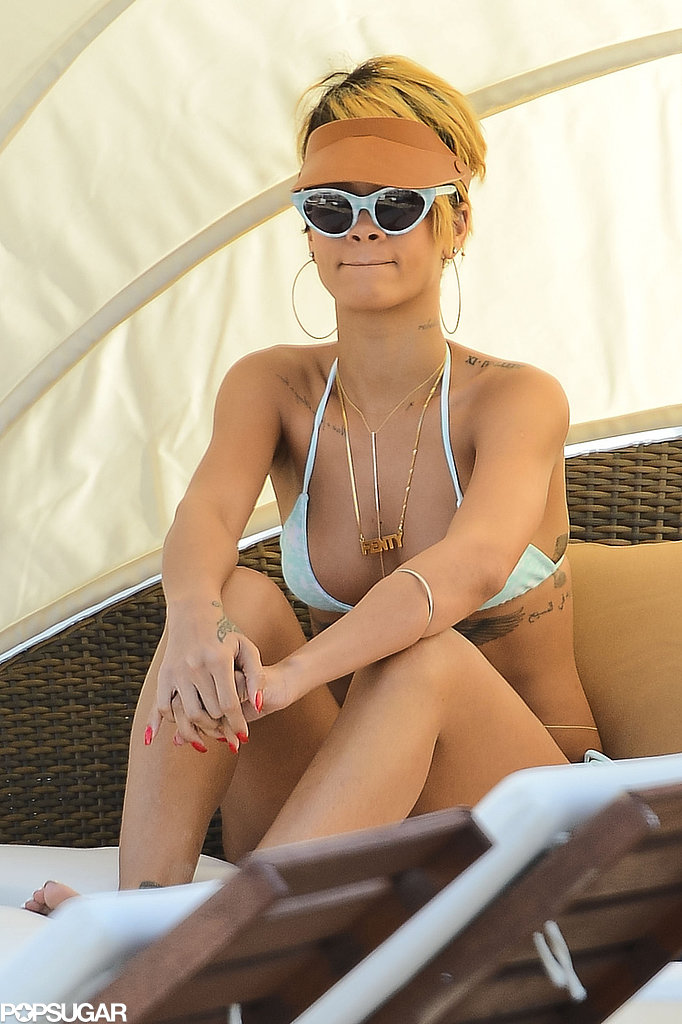 Rihanna lounged in a cabana on the beach.