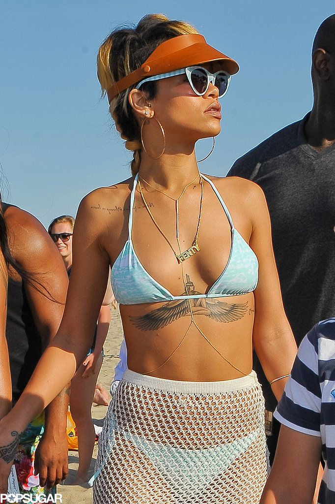 Rihanna Pops Up in Poland Rocking Fishnets and a Bikini