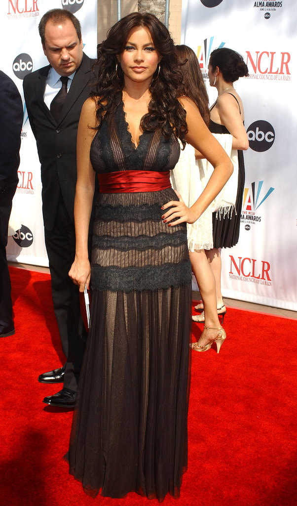 For the 2006 ALMA Awards, the brunette actress wore a sheer- and lace-paneled dress with a plunging neckline and red satin belt.