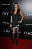 A sequined miniskirt, a jewel-embellished cami, and tough lace-up ankle boots made up Vergara's January 2011 party style.