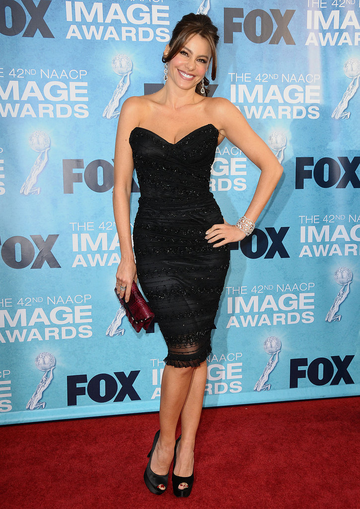 For the 2011 NAACP Image Awards, Sofia was all smiles in a structural sequined and striped dress by Dolce & Gabbana and satin peep-toes. A swept ponytail, tiered earrings, and a snake clutch added the finishing touches.