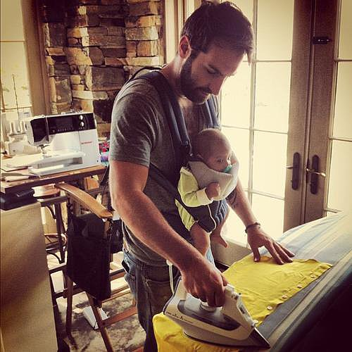 "Josh Kelley knew the key to multitasking with a baby was wearing the tot. He shared this photo with baby Adelaide, saying he was ""keeping it real"" with the tot in a BabyBjörn. Source: Instagram user joshbkelley"