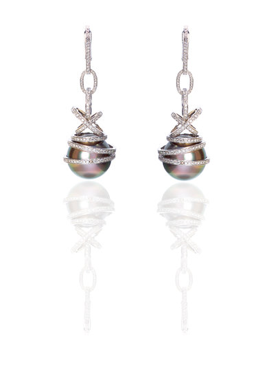 Gray cultured, pearl drop earring set in white diamond pavé and 18-karat white gold. Source: Chopard
