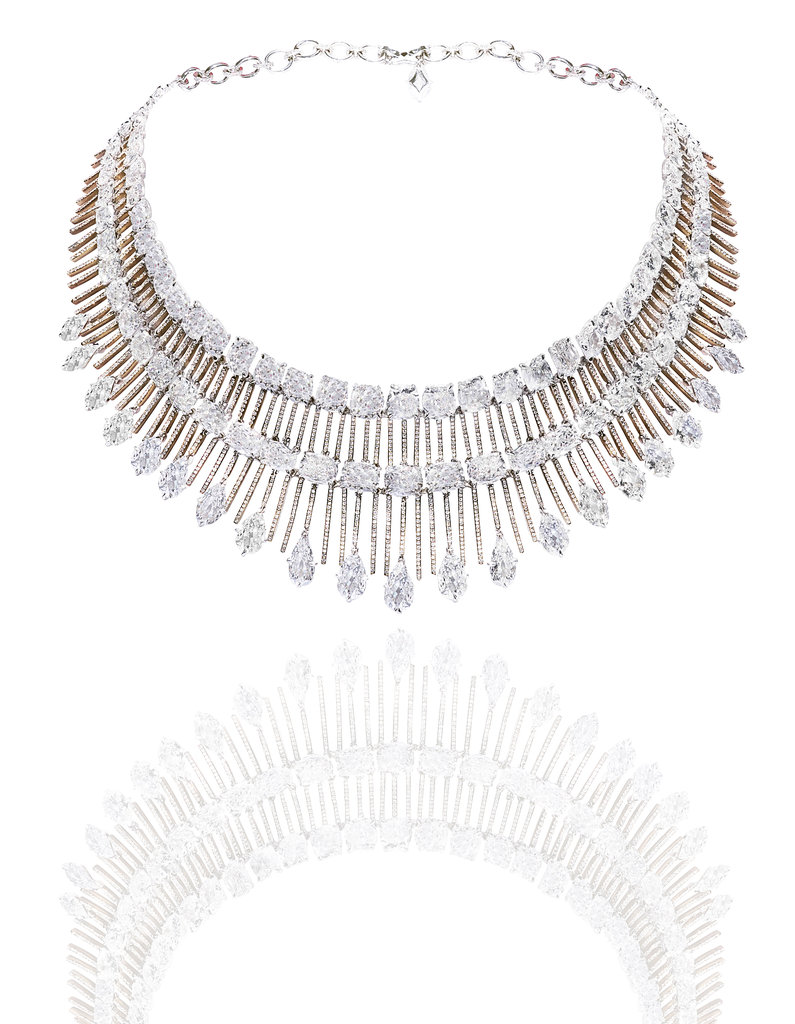 Cushion-shaped diamonds, pear-shaped and brilliant-cut white diamond collar necklace set in 18-karat white gold and titanium. Source: Chopard