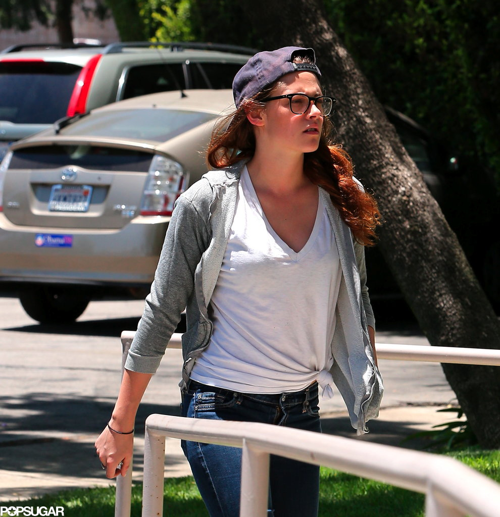 Kristen Stewart wore a backward-facing hat to head into a studio in LA.