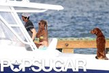 Anna Kournikova and Enrique Iglesias took their dogs along on a boat ride.