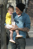 Harper got a lift from David while walking around West London in Apr. 2013.