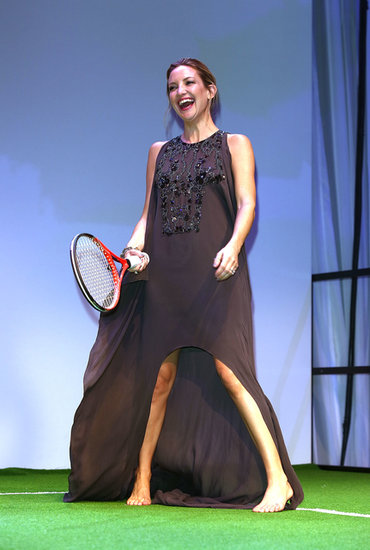 An Elie Saab-clad Kate Hudson shed her heels to show off her tennis skills at the Novak Djokovic Foundation gala in London.
