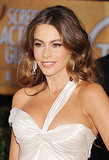 Her ombré locks were styled in voluminous waves, which she paired with dewy skin and bold brows at the 2013 SAG Awards.