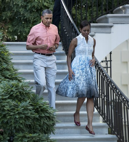 President Obama and Michelle Obama walked down to the White House's South Lawn with the first lady looking retro in a blue printed shirtdress and red patent ballet flats.