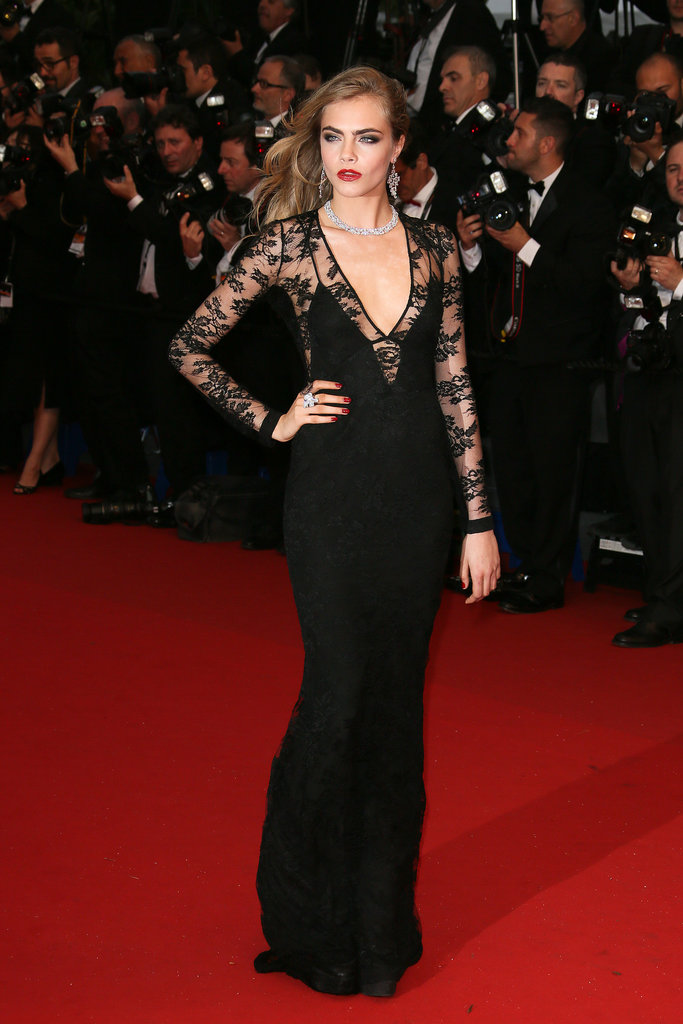 Cara proved she can pull off a gown with as much ease as she does a baseball cap in this black lace Burberry number.