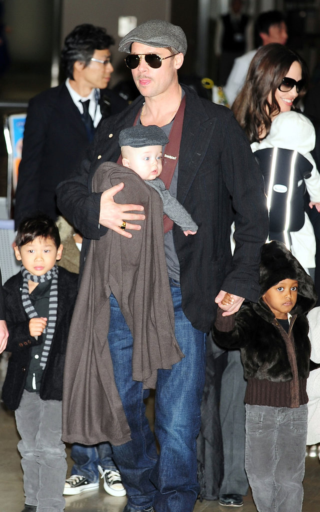 Angelina Jolie and Brad Pitt showed off their six kids when they arrived at an airport in Japan in January 2009.