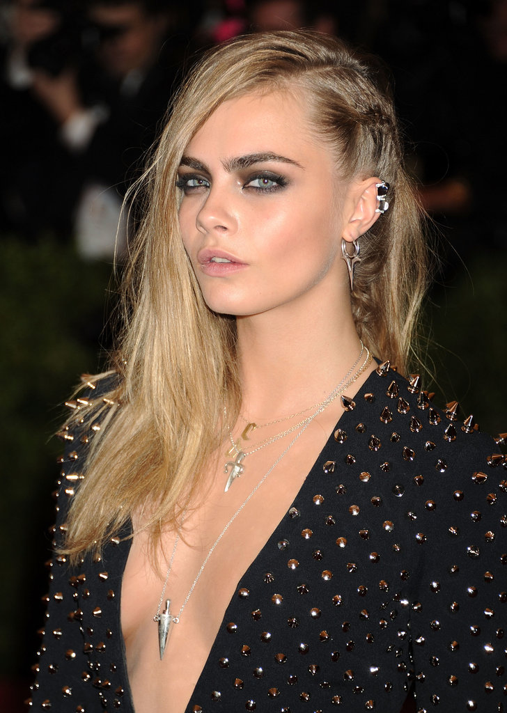 Give your sideswept style two-textured appeal by adding gel at the roots and a chunky braid à la Cara Delevingne.