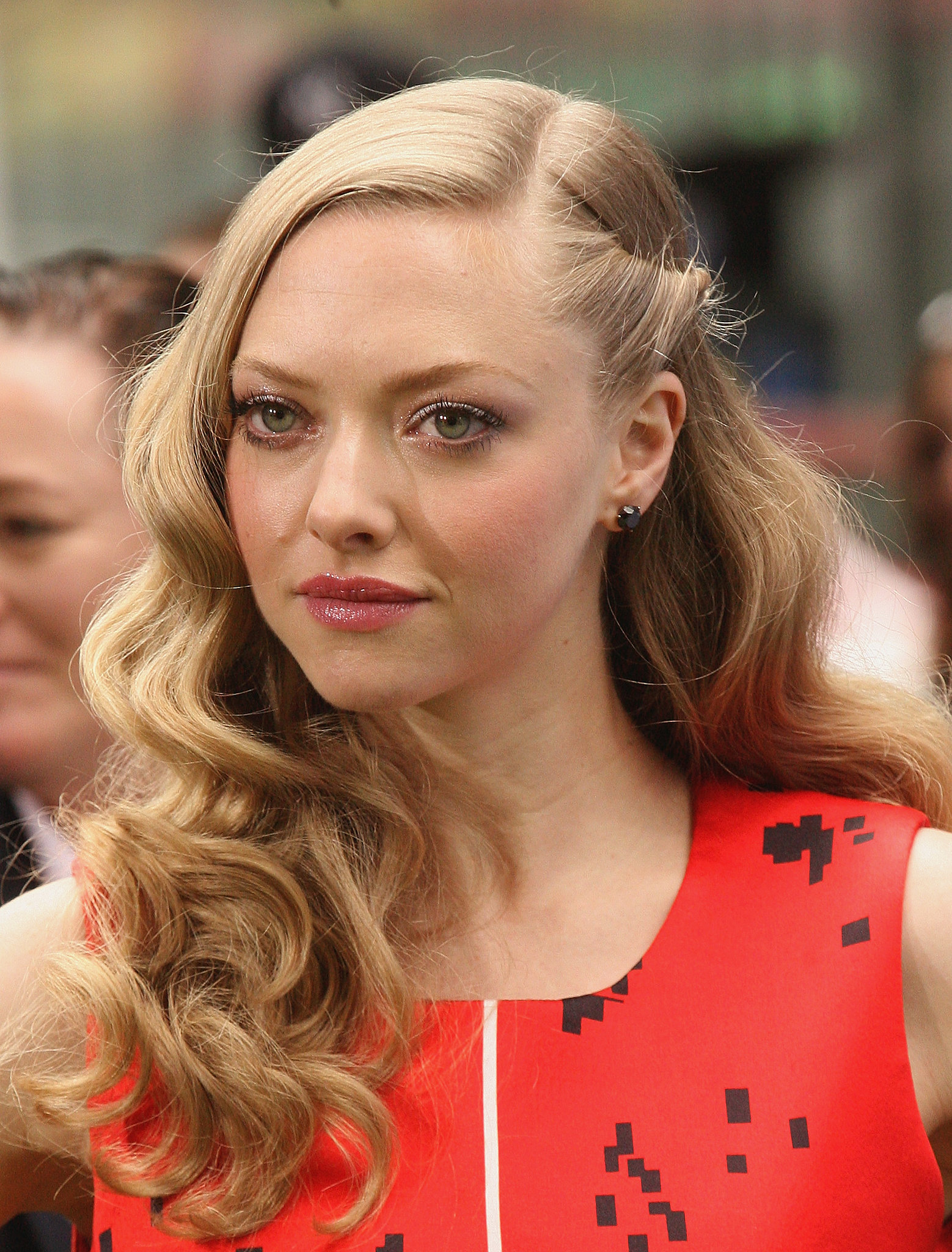 Go for a classic look like Amanda Seyfried. Start off with an extreme side part, then twist a section of hair near the ear and pin back.