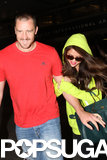 Selena Gomez held onto her stepdad's arm when she landed in LA.