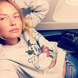 Lara Bingle looked snug as a bug in her cute Mickey Mouse jumper aboard a flight to Paris. Source: Instagram user mslbingle