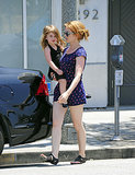 Isla Fisher carried her youngest daughter Elula as they walked to their car in Beverly Hills on July 9. Her other daughter with Sacha Baron Cohen, Olive, was trailing behind.