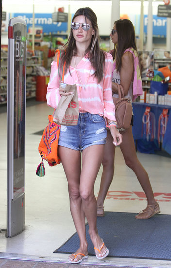 Alessandra Ambrosio amped up her denim cutoffs with a tie-dyed Bella Dahl blouse and mirrored aviators in Malibu, CA.