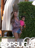 Beyoncé held on to Blue Ivy Carter as they made their way to the pool in Miami.