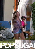 Beyoncé smiled while carrying Blue in her arms.