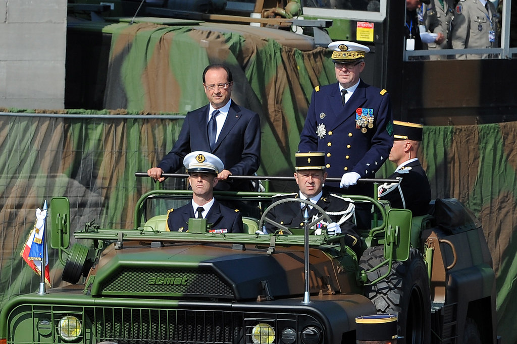 President Francois Hollande and the French army chief of staff, Admiral Édouard Guillaud, rode in a jeep down the Champs-Élysées.