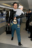 Orlando juggled Flynn and luggage while making his way through LAX in Jan. 2013.