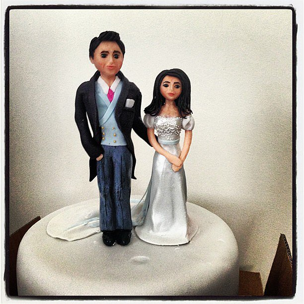 Top that! The couple adorned their cake with custom (and quite lifelike) figurines. Source: Instagram user derekblasberg