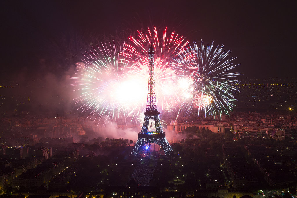 The Eiffel Tower was surrounded by fireworks on Bastille Day.