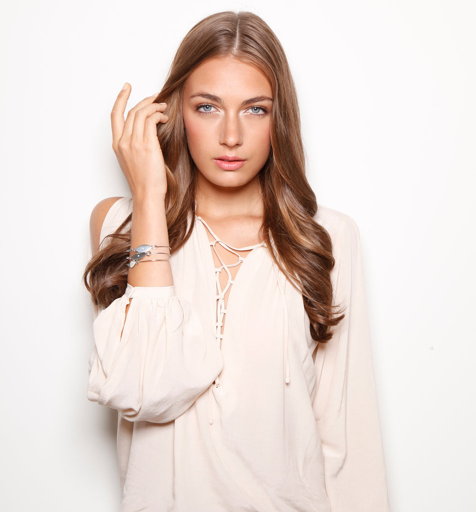 A stacked set of bangles calls to mind a bohemian vibe, so curl hair away from the face for loose waves with a middle part. Check out the Silver Evil Bangle ($24) to complement your low-maintenance style.