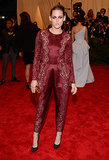 As modern-day punk royalty, we counted on Stewart to bring her edgy A-game to this year's Met Gala — and the actress didn't disappoint. The brunette beauty stunned in an oxblood lace-inset jumpsuit — complete with coordinating eye shadow and nail polish — studded pumps, and a mirrored box clutch, all by Stella McCartney.