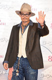 Johnny Depp wore a hat and jeans.
