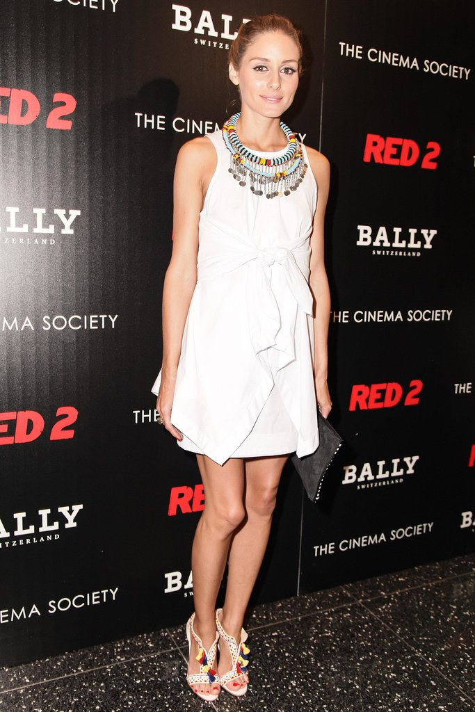 Olivia Palermo amped up her little white dress featuring a knot detail with a beaded coin necklace and tassel-adorned sandals at a Bally party in NYC.