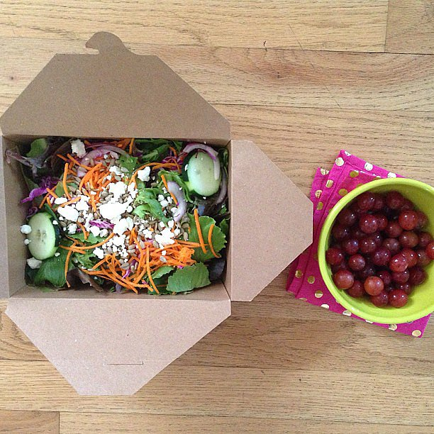 Even when eating out, lunch can still be healthy. Check out this organic mesclun salad mix with veggies, feta, and sunflower seeds. For dessert? Organic red grapes! Source: Instagram user clean_eats_whitney